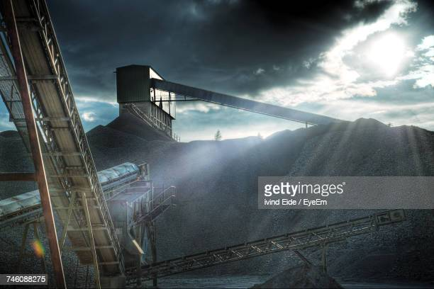 conveyor belts in mine against sky - mining stock photos and pictures