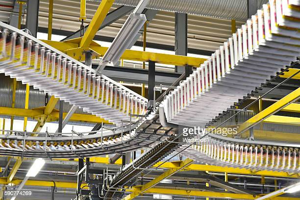 conveyor belts with newspapers in a printing shop - automation stock pictures, royalty-free photos & images