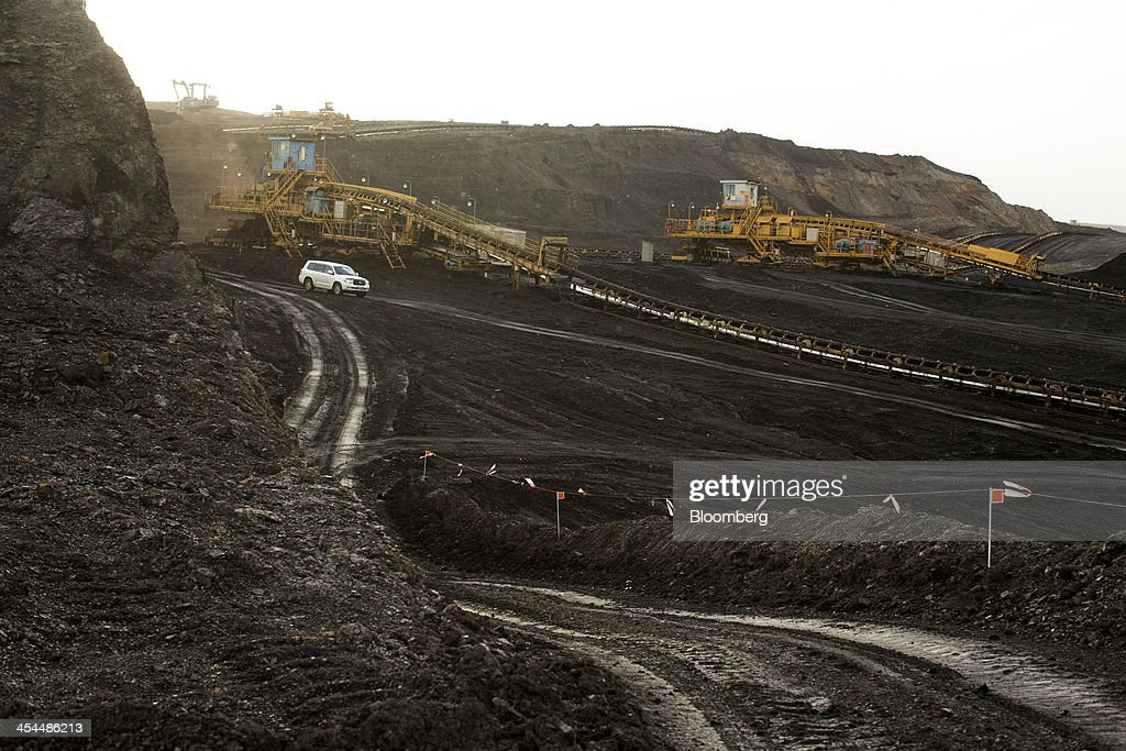Conveyor machines transport excavated lignite, also known as brown coal, in the open pit mine operated by Czech Coal AS near the town of Horni Jiretin, Czech Republic, on Friday, Dec. 6, 2013. The government may set up a joint company with Severni Energeticka that will seek lifting current environmental limits on lignite mining, Lidove Noviny reports, citing proposal submitted by Industry and Trade Ministry. Photographer: Bartek Sadowski/Bloomberg via Getty Images