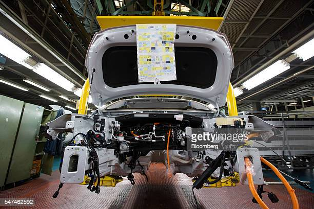Conveyor moves a Hyundai Motor Co. Ioniq electric vehicle on the production line at the company's plant in Ulsan, South Korea, on Monday, July 4,...