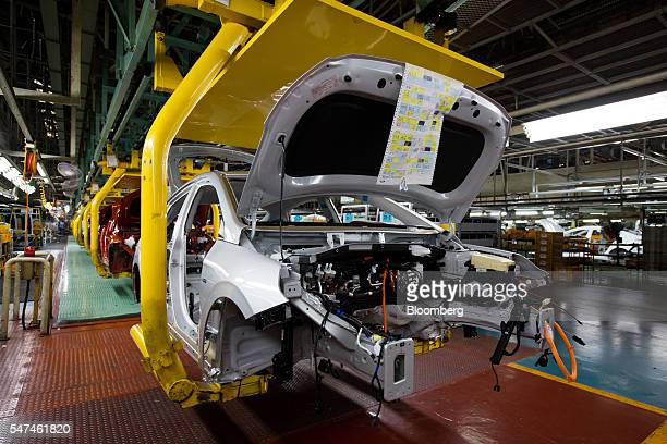 Conveyor moves Hyundai Motor Co. Ioniq electric vehicles on the production line at the company's plant in Ulsan, South Korea, on Monday, July 4,...