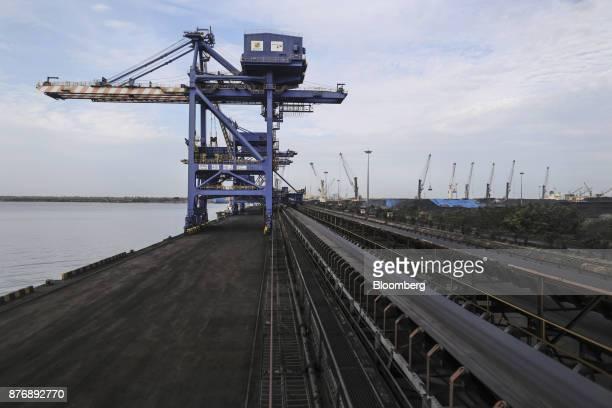 A conveyor runs past gantry cranes at Krishnapatnam Port in Krishnapatnam Andhra Pradesh India on Saturday Aug 12 2017 Growth in gross domestic...