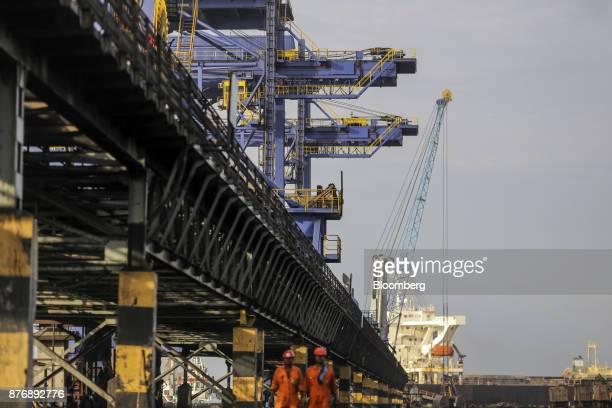 A conveyor runs past gantry cranes operating at Krishnapatnam Port in Krishnapatnam Andhra Pradesh India on Saturday Aug 12 2017 Growth in gross...