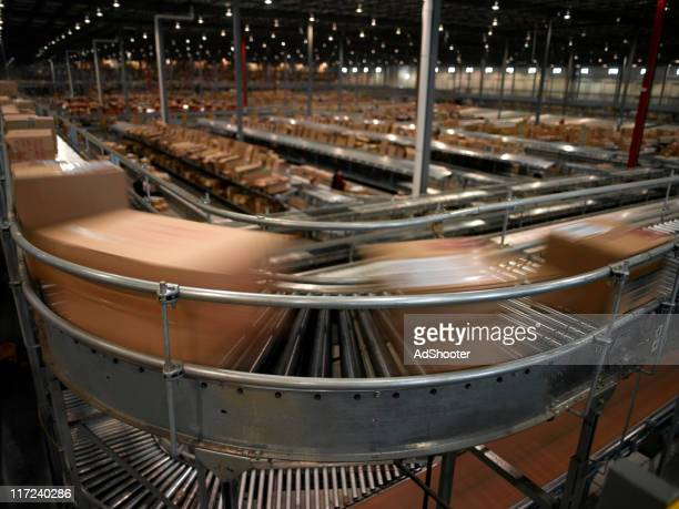 conveyor system - automation stock pictures, royalty-free photos & images