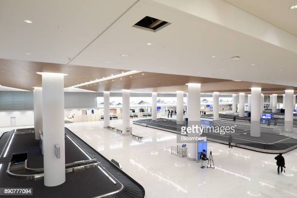 Conveyors are seen in the baggage reclaim hall inside the nearly completed terminal 2 building during a media preview at Incheon International...