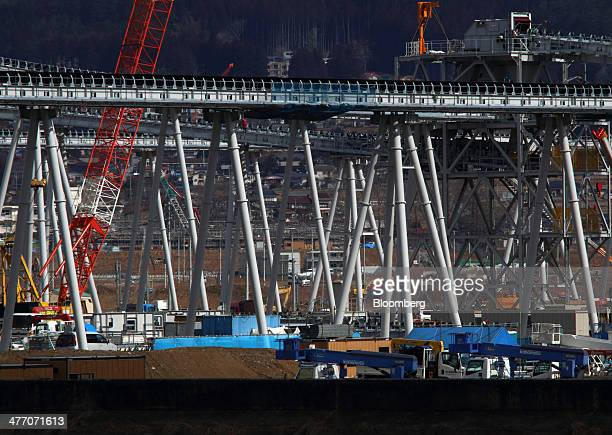Conveyors carry excavated soil to a residential area under construction in Rikuzentakata Iwate Prefecture Japan on Thursday March 6 2014...