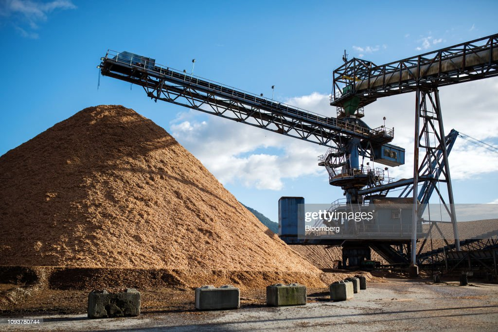 Conveyors move wood chips in the storage yard at the Howe