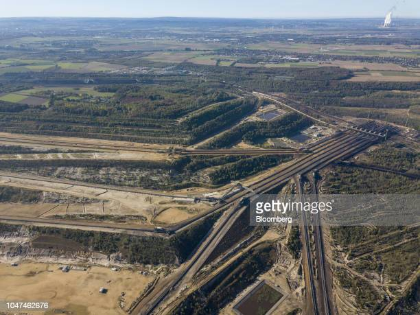 Conveyors run across the open pit lignite mine operated by RWE AG in Hambach Germany on Friday Oct 5 2018 The world must invest $24 trillion in clean...