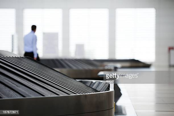 conveyour belt at airport - red belt stock photos and pictures