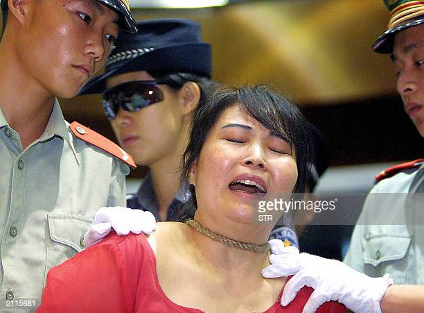 Convicted drug pedlar Wang Xiongyin breaks down as she Is sentenced to death for selling 200 grams of heroin for 27000 yuan back in 1999 in Guangzhou...