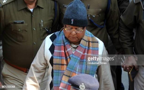 Convicted former Chief Minister of Bihar Lalu Prasad under heavy security arrives at special CBI court in connection of fodder scam case on January 4...