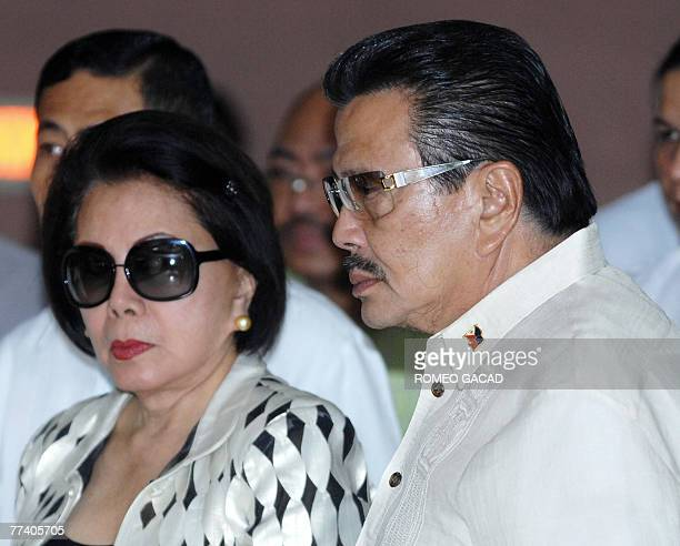 Convicted former president Joseph Estrada accompanied by his wife former senator Luisa Ejercito enters the courtroom of Sandiganbayan antigraft in...