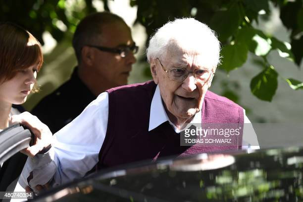 A convicted former SS officer Oskar Groening leaves after the verdict in his trial on July 15 2015 at court in Lueneburg northern Germany Oskar...