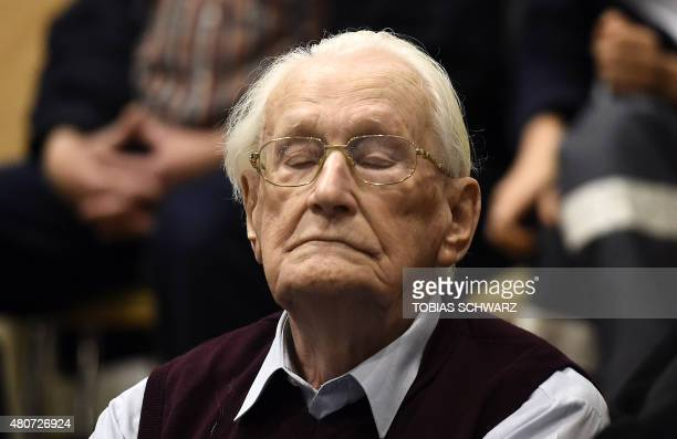 Convicted former SS officer Oskar Groening listens to the verdict of his trial on July 15 2015 at court in Lueneburg northern Germany Oskar Groening...