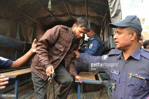 A convicted Islamist militant is escorted by Bangladesh police outside a court in Rangpur on February 28 after being handed a death sentence over the...