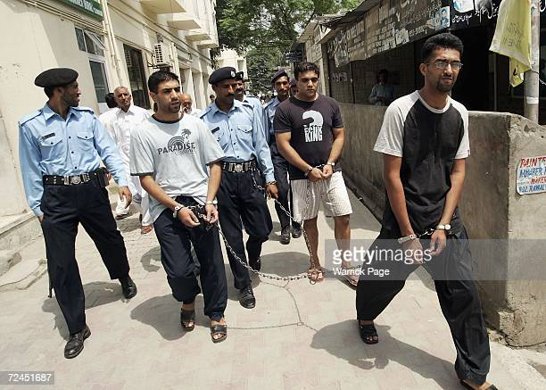Convicted killers Zeeshan Shahid , Imran Shahid and Mohammed Faisal Mushtaq leave an extradition hearing on August 26, 2005 in Islamabad Pakistan....