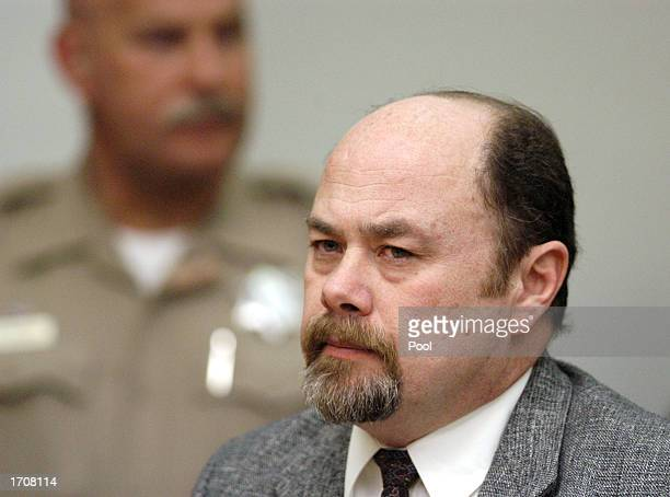 Convicted murderer David Westerfield listens to arguments in his death penalty court hearing at the Superior Courthouse January 3 2002 in San Diego...
