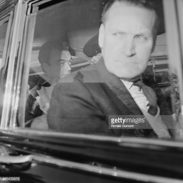 Convicted murderer Harry Roberts sits in the back of a car while on his way to the Inner London Crown Court to give evidence as a witness at the...