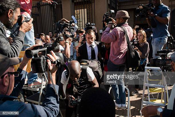 Convicted murderer Oscar Pistorius arrives in court for his appearance for a postponement of his sentencing hearing at the North Gauteng High Court...