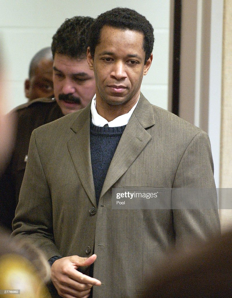 Convicted sniper John Allen Muhammad is escorted into courtroom 10 at the Virginia Beach Circuit Court November 24, 2003 in Virginia Beach, Virginia. The jury is beginning the second day of deliberations in the sentencing phase of the trial.