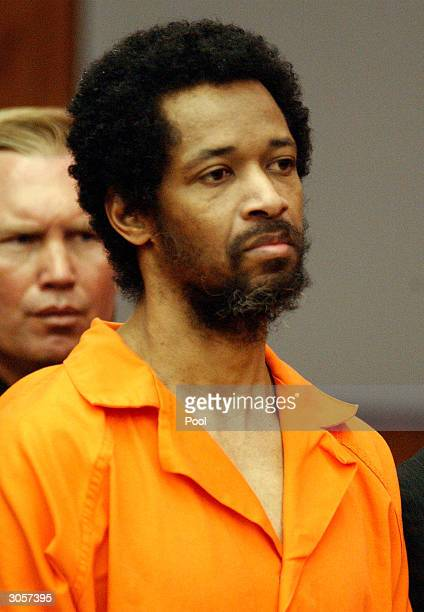 Convicted sniper suspect John Allen Muhammad stands expressionless as he is sentenced to death for the shooting of Dean Meyers at the Prince William...