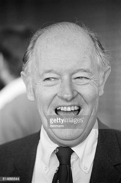 Convicted Watergate burglar E. Howard Hunt laughs outside a court house in Miami during his libel trial against a right wing magazine.