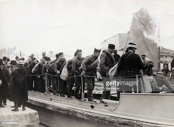340 convicts boarding barge which will take them out to the cargo boat Martiniere for their final destination of Devil's Island Devil's Island of the...