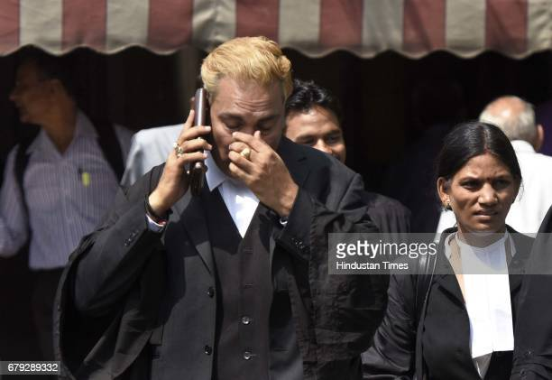 Convicts lawyer A P Singh after the Supreme Court pronounced verdict on the appeals filed by four death row convicts against death penalty in the...