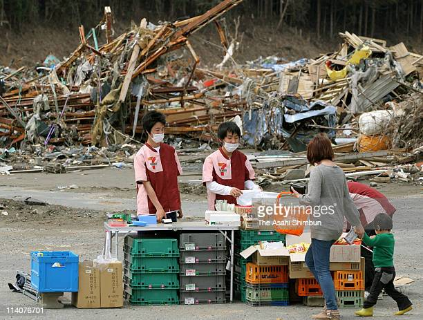 """Convienience store """"Seven Eleven"""" reopens among the debris at the place where the store used to be, on May 11, 2011 in Minamisanriku, Miyagi, Japan...."""