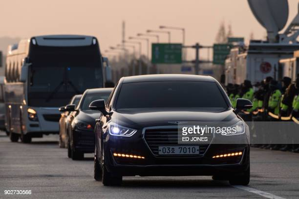 A convoy carrying a delegation of South Korean officials passes a checkpoint leading to the truce village of Panmunjom near the Demilitarized Zone...
