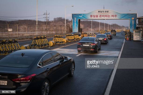 TOPSHOT A convoy carrying a delegation of South Korean officials passes through a checkpoint leading to the truce village of Panmunjom near the...