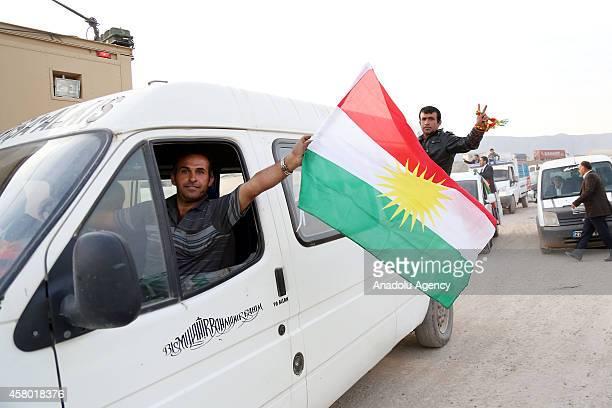 A convoy carrying heavy weapons belonging to Iraqi Kurdish Peshmerga forces crosses into Turkey from the Habur border crossing on TurkishIraqi border...