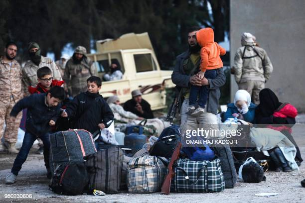 A convoy carrying opposition fighters and their families from the East Qalamun area 60 kilometres northeast of Syria's capital arrives in Qalaat...