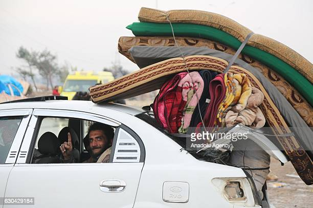 A convoy evacuating civilians and opposition group members who left east Aleppo that had been under siege by Assad regime and its supporter foreign...