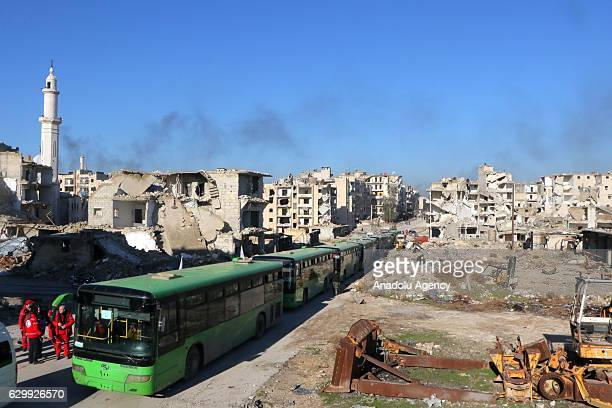 A convoy including busses and ambulances welcome evacuated civilians fled from East Aleppo where had been under siege by Iran led Shiite militias and...