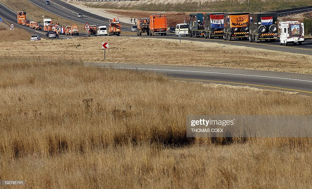 A convoy of 140 'Oranje' vehicles with supporters of The Netherlands' football team drives on a motorway from the Fountainvalley camp, northern Johannesburg on June 16, 2010. Around 700 Dutch fans will move from Johannesburg to Durban, where their team will play their second 2010 Football World Cup match against Japan on June 19.