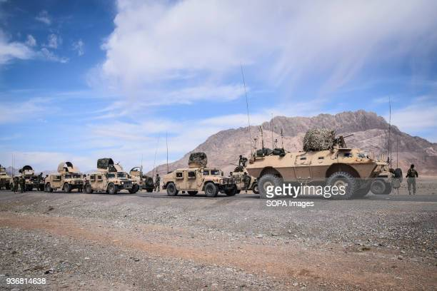 FARAH AFGHANISTAN Convoy of Afghan Commando Company consisting of HMMWVs and Mobile Strike Force Vehicles resting on the main road in Bolo Bluk...