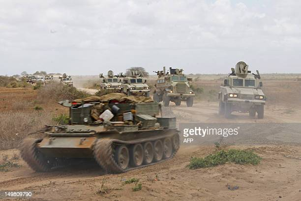 A convoy of African Union Mission in Somalia armored vehicules passes through the KM50 airstrip on their way to the town of Merca 88 kilometers north...