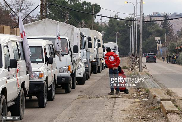 A convoy of aid from the International Committee of the Red Cross waits on the outskirts of the besieged rebelheld Syrian town of Madaya on January...