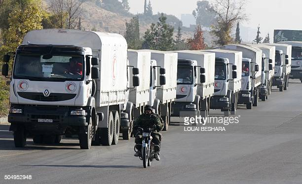 A convoy of aid from the Syrian Arab Red Crescent leaves the capital Damascus for the besieged rebelheld Syrian town of Madaya on January 14 2016 The...