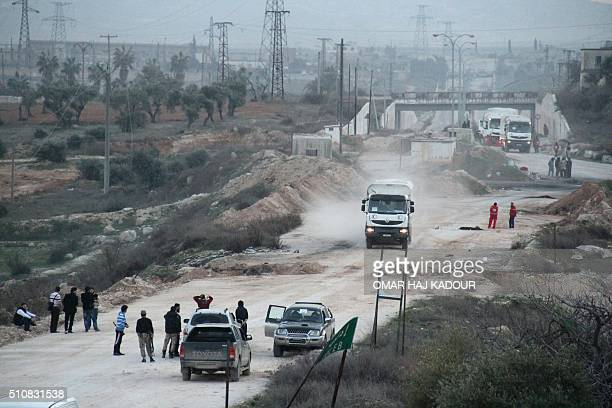 A convoy of aid vehicles heads to the governmentheld Shiite towns of Fuaa and Kafraya in northwestern Idlib province on February 17 during an...
