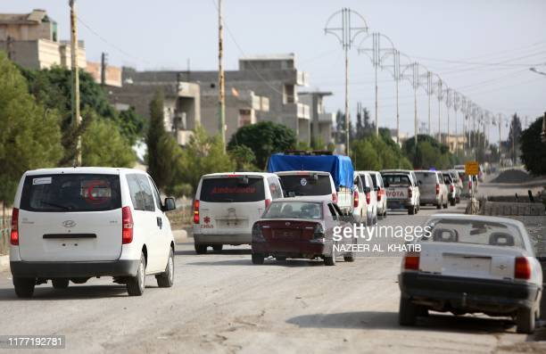 A convoy of ambulances and other vehicles evacuating fighters and injured members of the Kurdishled Syrian Democratic Forces as a well as wounded...