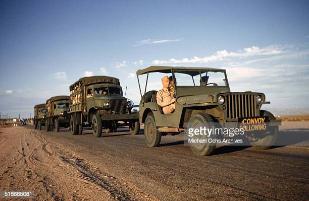 A convoy of Army trucks drives at the Las Vegas Army Air Force Airfield in Las Vegas Nevada Circa 1942
