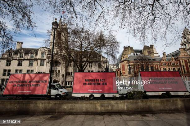 A convoy of billboard vans with messages against antisemitism in the Labour Party are driven around Westminster on February 21 2018 in London England