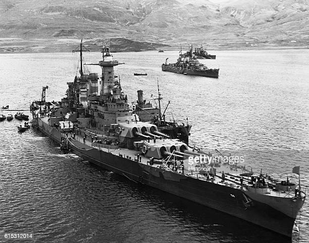 A convoy of British and American ships ride at anchor in the harbor at Hvalfjord Iceland MayJune 1942 | Location Hvalfjord Iceland