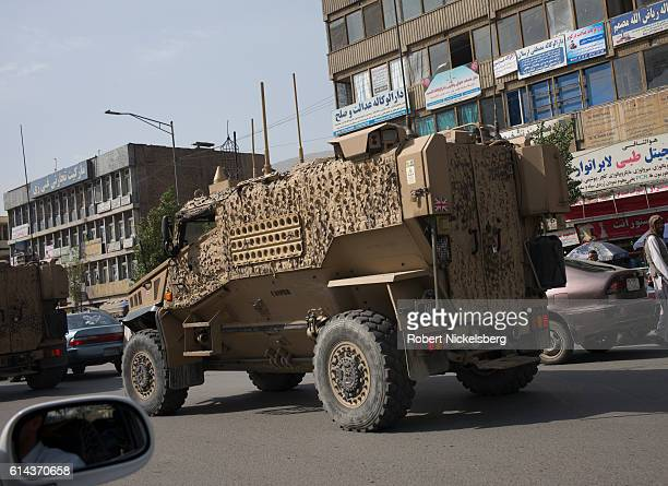 Convoy of British Army Mine Resistant Ambush Protected, or MRAPs, known as Foxhounds, works it's way through morning traffic jams in downtown Kabul...
