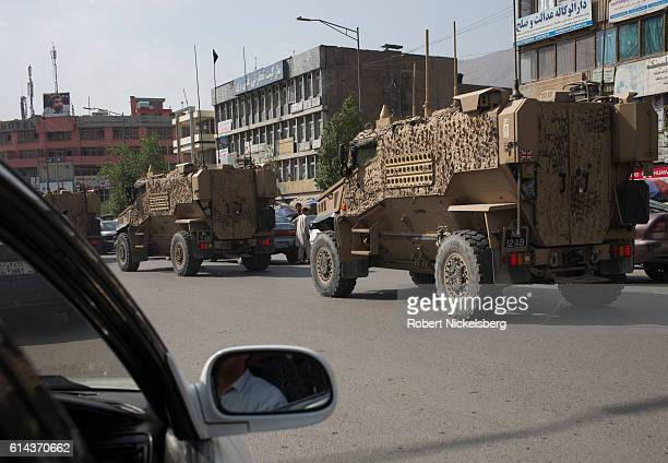 A convoy of British Army Mine Resistant Ambush Protected or MRAPs known as Foxhounds works it's way through morning traffic jams in downtown Kabul on...