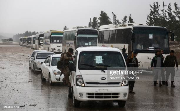 A convoy of buses carrying people evacuated from the central Syria Homs provice arrives at Abu alZandin checkpoint near alBab in northern Syria on...