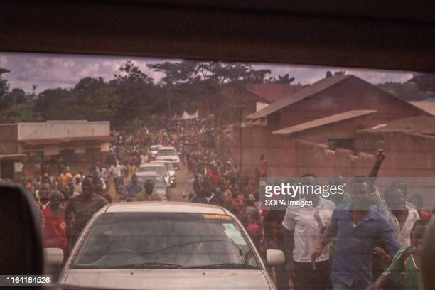 Convoy of cars and supporters of Bobi Wine during a campaign event in Gombe Bobi Wine whose real name is Robert Kyagulanyi a popstar and opposition...