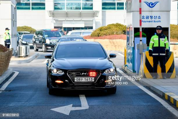 A convoy of cars carrying North Korea's highlevel delegation transfers from Incheon airport west of Seoul on February 9 to a train station following...